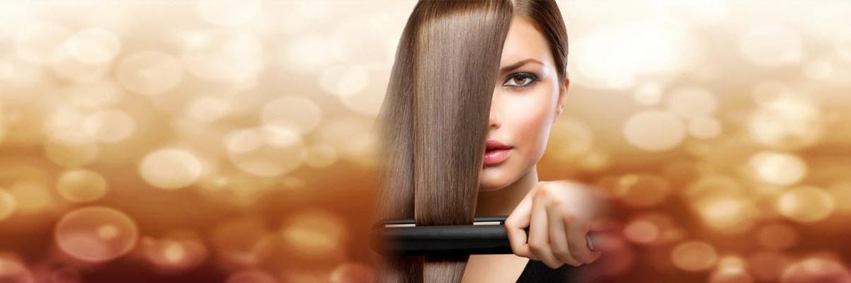 Women using a hair straightener