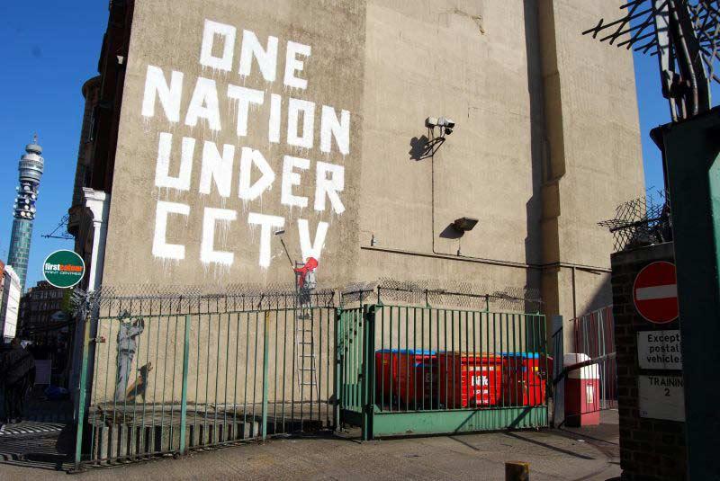 Graffiti about cctv by artist Banksy.