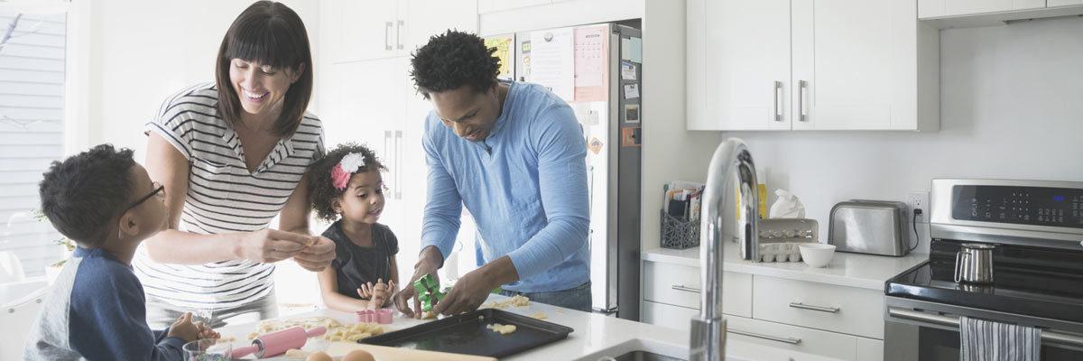 Family preparing food at home