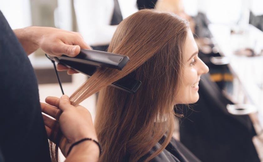 hair stylist straihtening hair