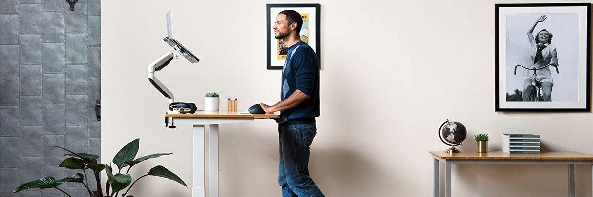 man behind standing desk
