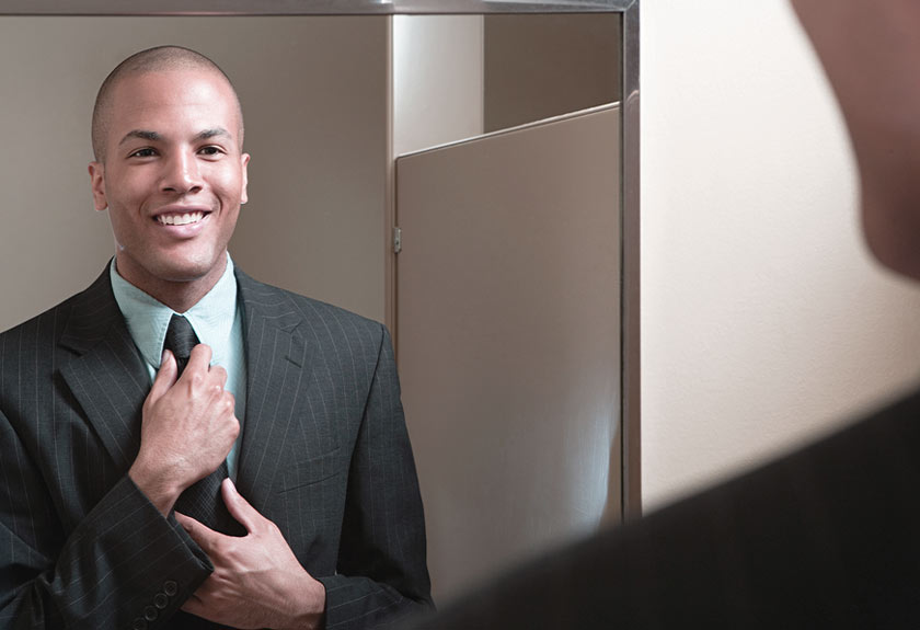 man checking his tie