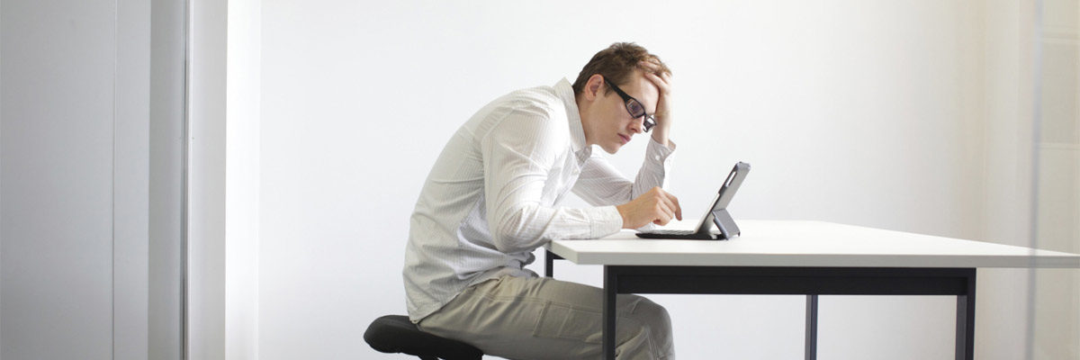 health compromising sitting posture while working