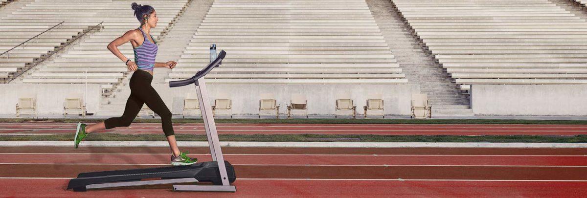 Woman running a treadmill on athletics track