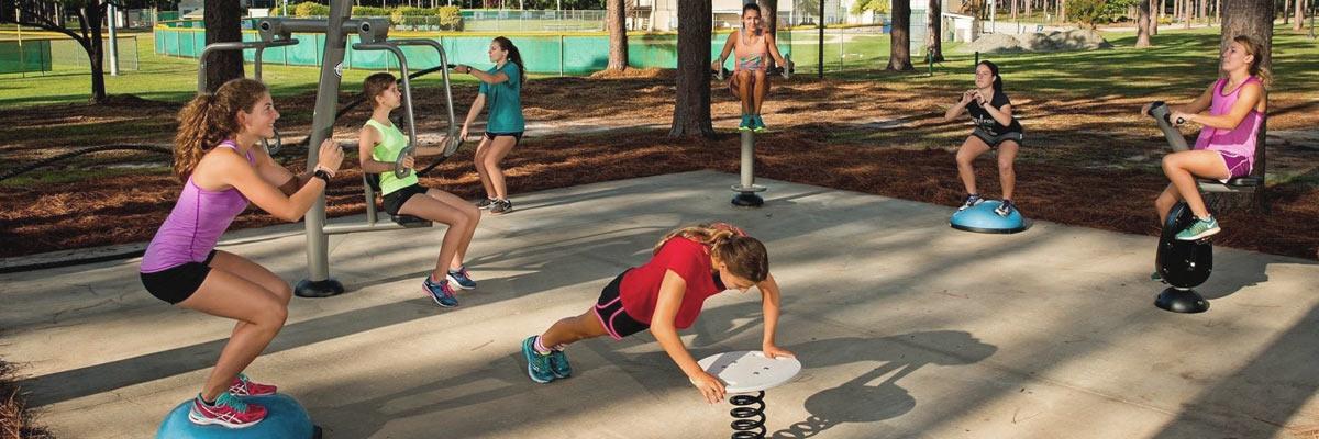 Girls doing sport exercises outside