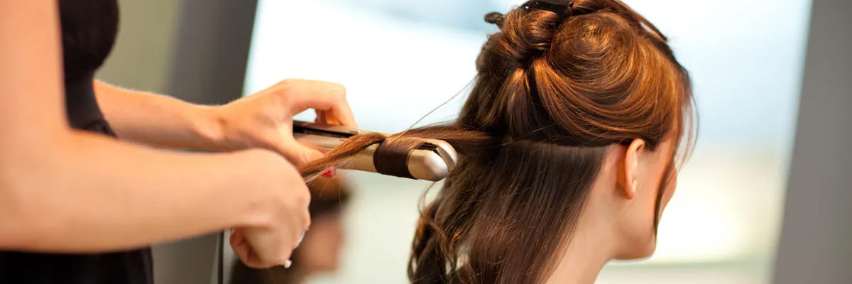 styling with a flat iron