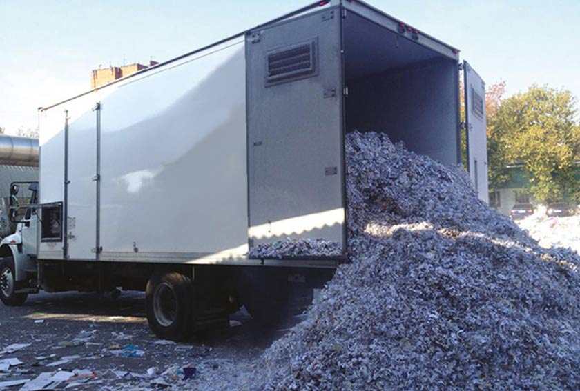 truck unloading shredded paper waste