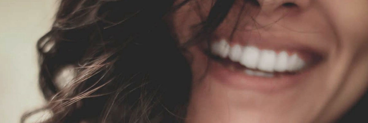 close up of woman smiling with beautiful white teeth